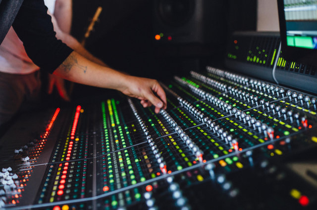 Studio Engineers' Mixing Desk image by WaldMedia (via Shutterstock).